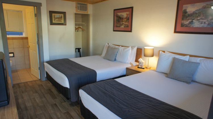 2 Queen beds with microwave, mini-fridge, cable TV, and free wi-fi